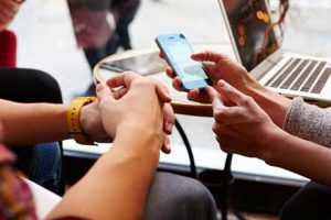 People chatting over mobile devices